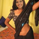 Color Swathi Reddy nude navel show in hot black saree