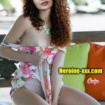 Heroine Aathmika cleavage xxx mini skirt hot photoshoot session