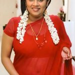 Hot mom Lakshmy Ramakrishnan wearing transparent red Saree deep navel see though