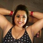 Hot milf Meena showing her shaved armpit in black bra